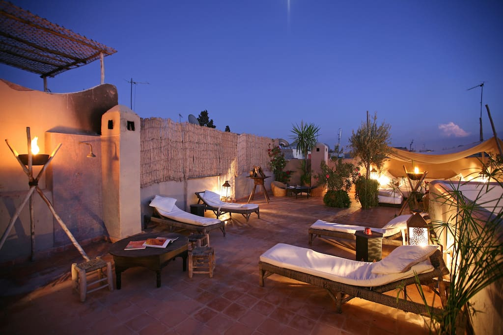 Enjoy the terrace at night with cosy fires and tents