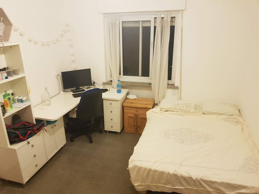 the bedroom is spacious and has the cool breeze in the morning