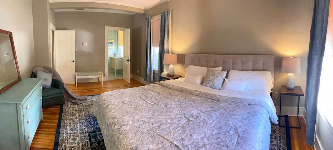 King sized bed in master bedroom features ensuite bathroom.