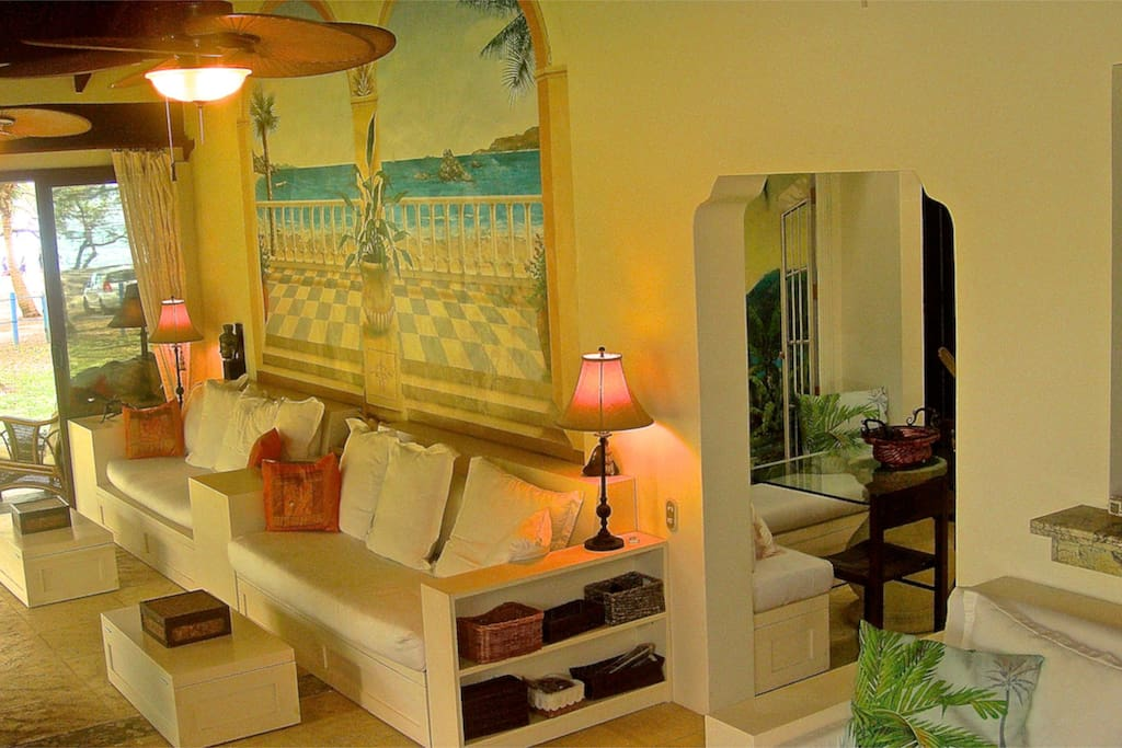 35' Livingroom with soaring Cathedral Ceilings and stunning view of the Pacific. Three huge palm ceiling fans add to the tropical romance