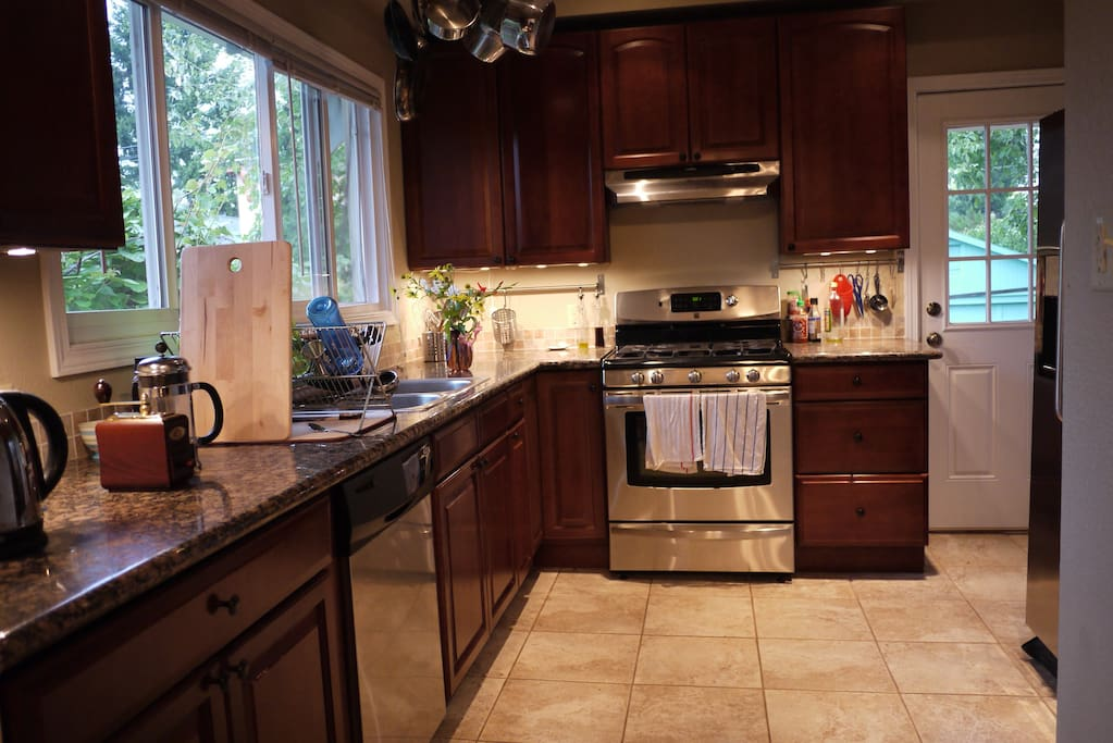 Fully equipped kitchen with gas range and dishwasher