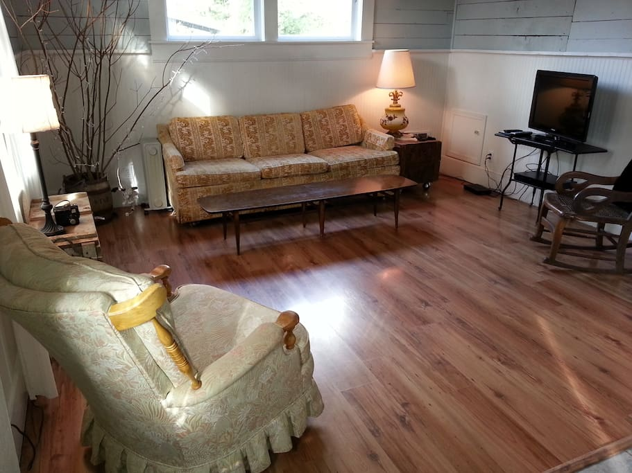 Livingroom has vintage and antique furniture, plus cable t.v.