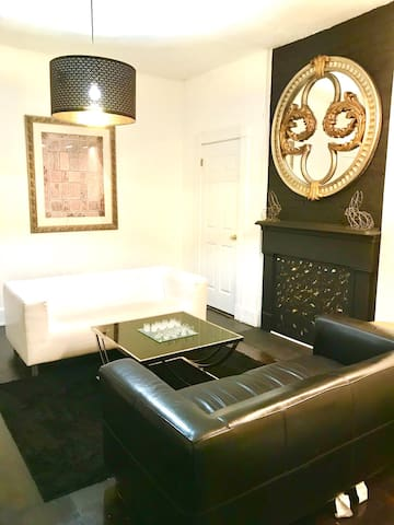 Our spacious beautiful living room with high ceilings. It is equipped with 2 sofas, a large coffee table, 55' tv, a floor lamp, full size mirror, some art and decor pieces.