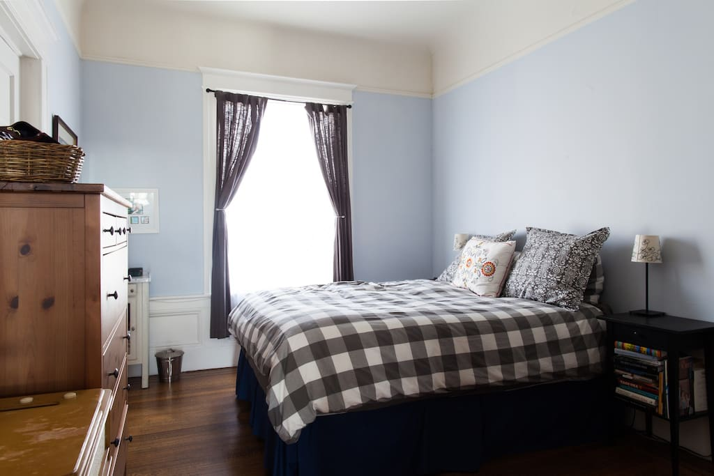 Master bedroom with crown moldings faces a quiet (for San Francisco!) street.