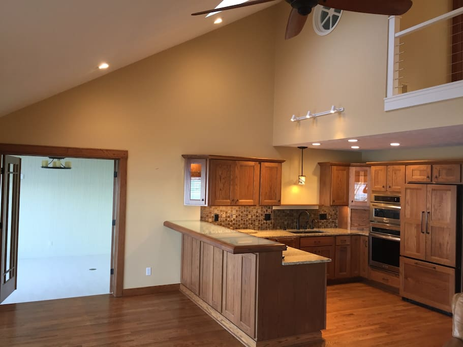 Completely renovated kitchen that overlooks the main living area with picture perfect views of Klinger Lake