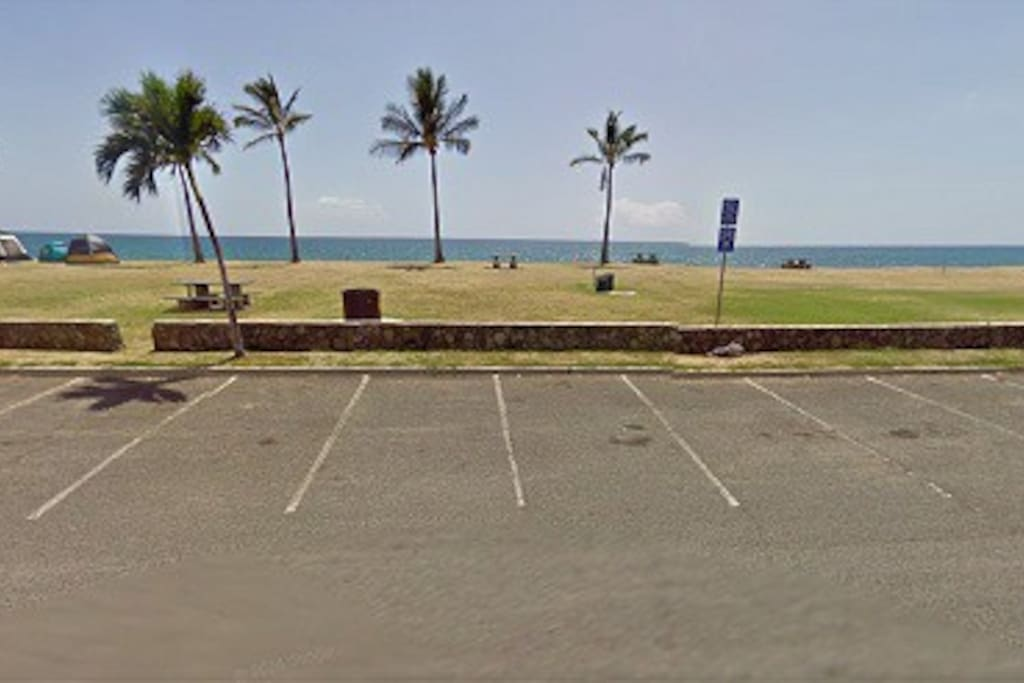 Parking lot to Maili beach park across the street from the house
