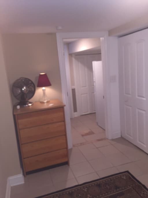 view of chest of drawers from room corner and out to hallway.