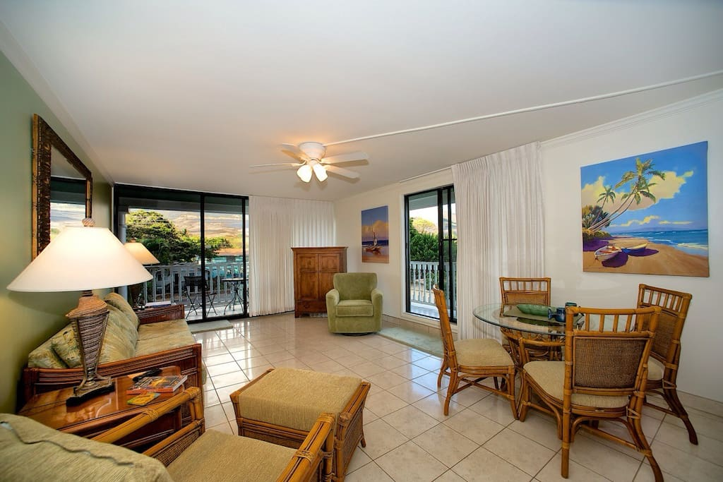 The living room has two balconies, one of which faces the Maui Mountains; the other, a partial view of the ocean. Convertible queen size couch, sleeps 2.