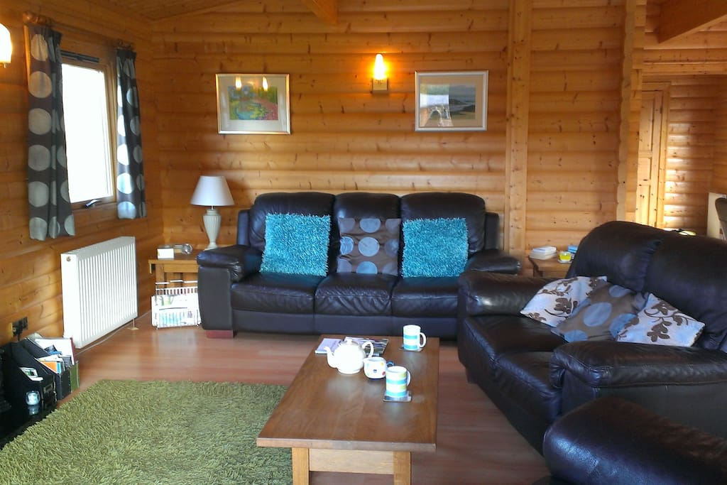 Spacious accommodation, open plan lounge with 2 sofas & armchair