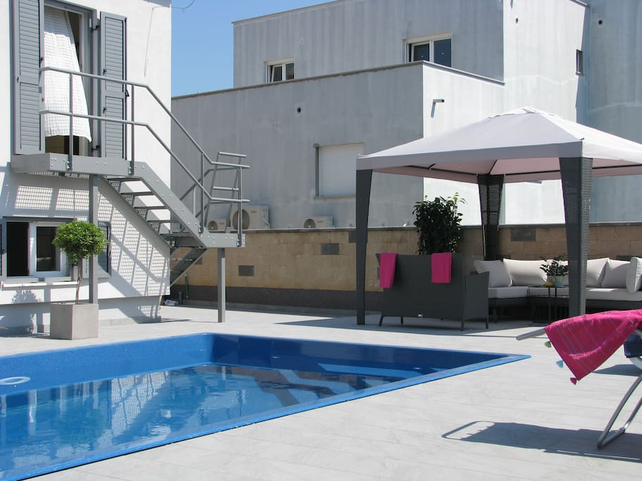 Stairs from top apartment to pool & backyard