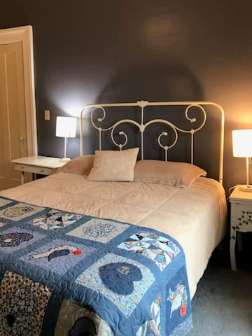 "Queen bed with handmade ""Lancaster"" quilt - hearts and distlefinks, the Pennsylvania Dutch bird."