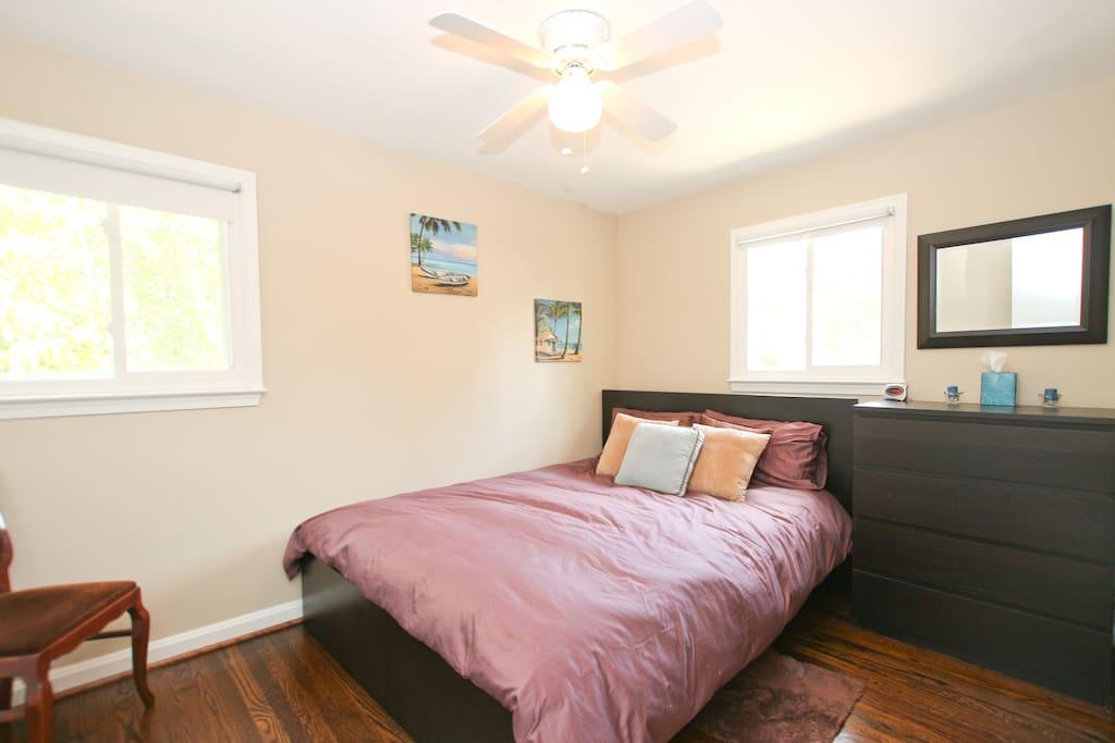 Bedroom with Queen bed and dresser
