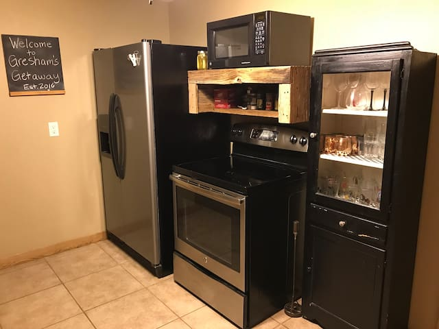 Complete with refrigerator/freezer and ice maker, microwave, stove and all cookware and cooking utensils