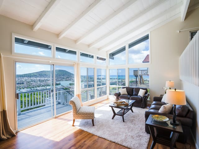 The main living area boasts stunning 270-degree vistas of the ocean and mountains.