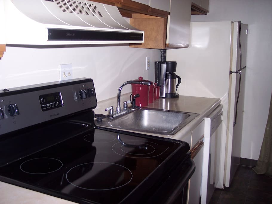 Fully equipped kitchen with stove, fridge, dishwasher. China, glassware and silverware included.