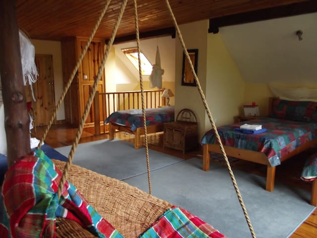 The Upper Room with 5 single beds, great views, and a small bathroom.