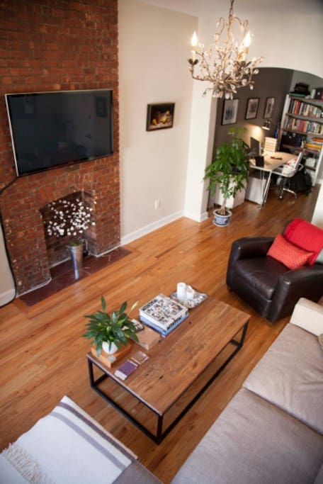 Living room with exposed brick fireplace