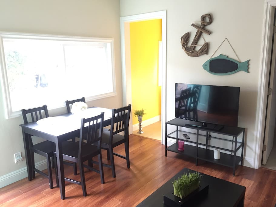 Living room with dining table and TV