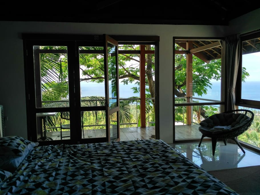 the room looking to the ocean and pool
