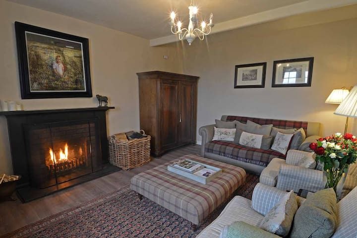 The warm, welcoming sitting room of Kinnighallen with an open fire for you to cosy up to at night....blankets and board games (and Sky TV if you prefer to have a movie night)....