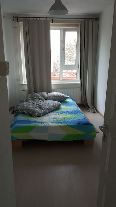 bedroom with double bed and extra bed cover