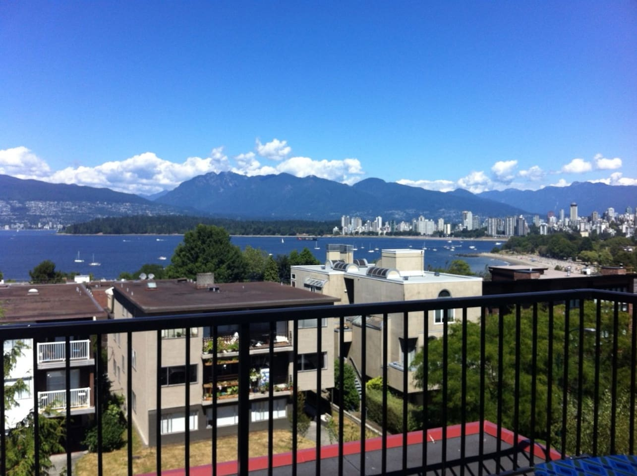 SPECTACULAR view of ocean, mountains, and city from private balcony
