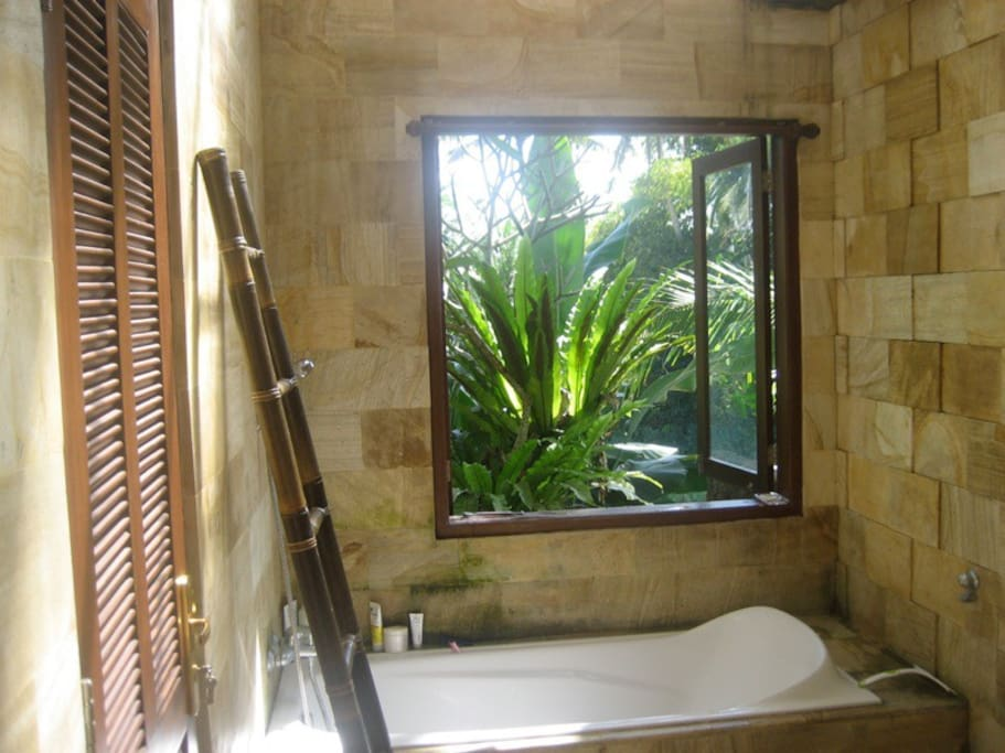 Bath and shower with natural open air garden and nature view.