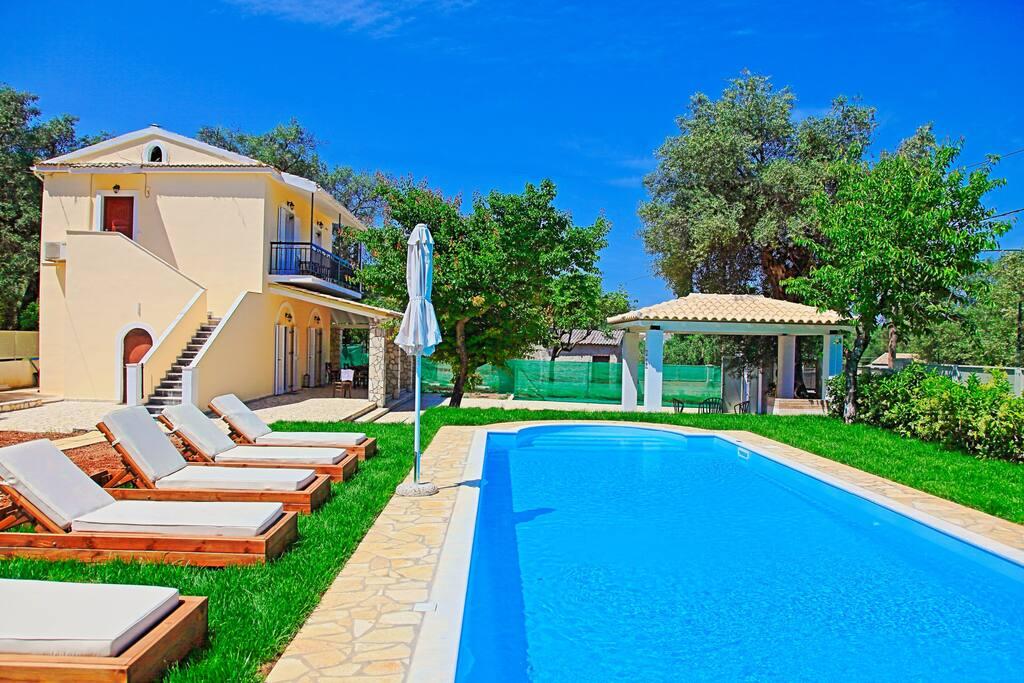 Sun-loungers around the pool