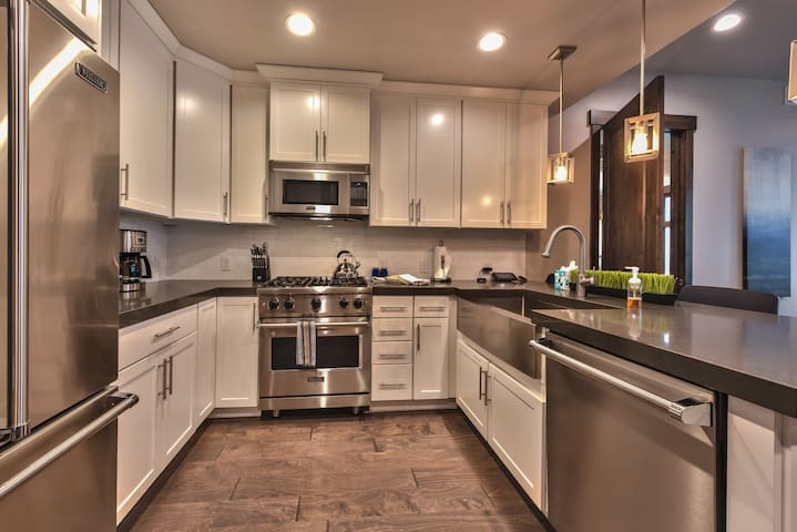 Gourmet Kitchen with Viking Appliances, Lovely Granite Counters, and a Stainless Farm Sink