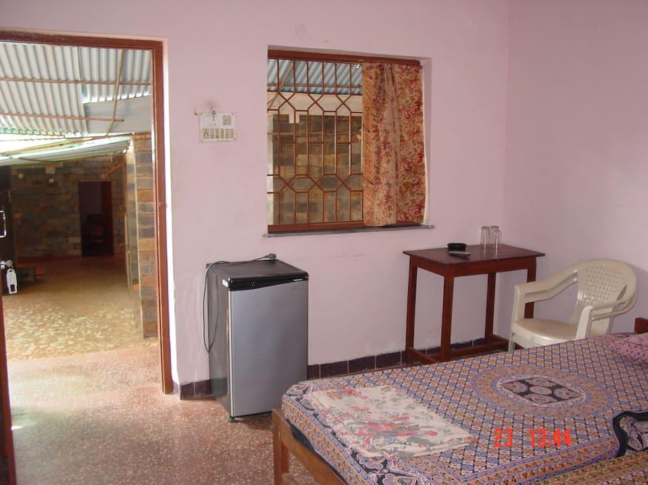 Room Amenities include Tv, Fridge and Hotshower