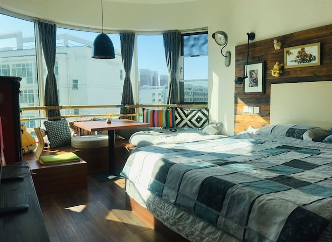 A spacious bedroom, enjoying wonderful sunshine in the winter time.