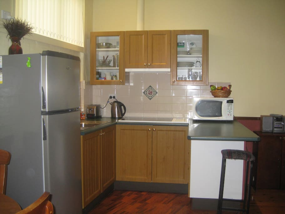 Well appointed kitchen with full size Fridge and microwave, Crockery, Cutlery, etc.