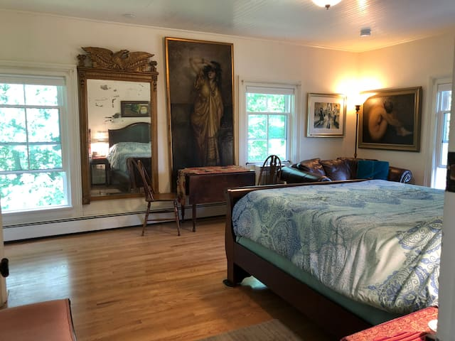 Bedroom suite with private bath, Q size bed with great mattress and boxspring, tv, comfortable sofa, hassock, table and chairs, desk.