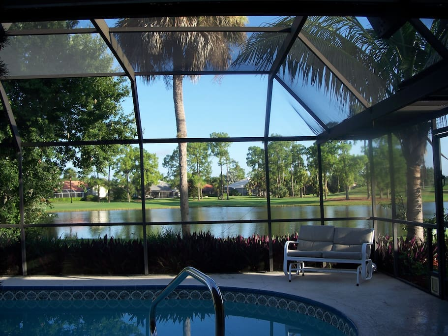 heated pool overlooking lake and golf course