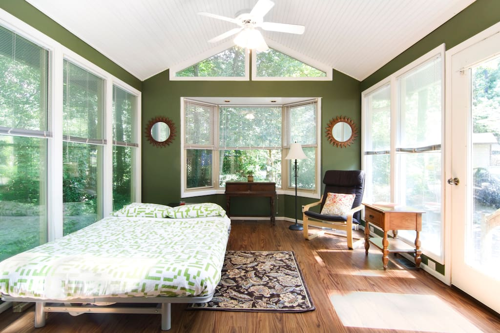Sunroom converts to 2nd bedroom.  Queen sized futon with slat base is very comfortable.