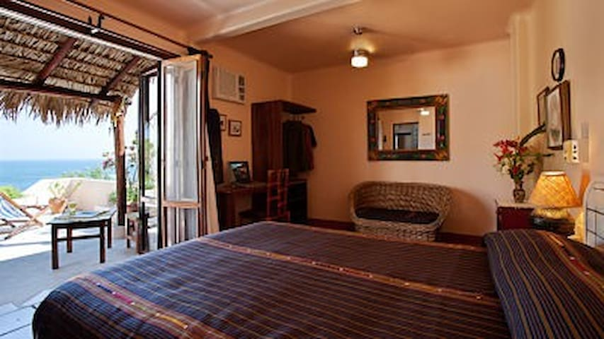 The Delfin room has a queen bed, A/C and fan and attached bathroom