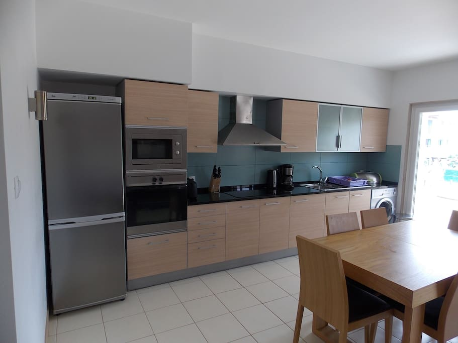 modern Kitchen with full fridge freezer , microwave , hob , washer , juicer and coffee percolator