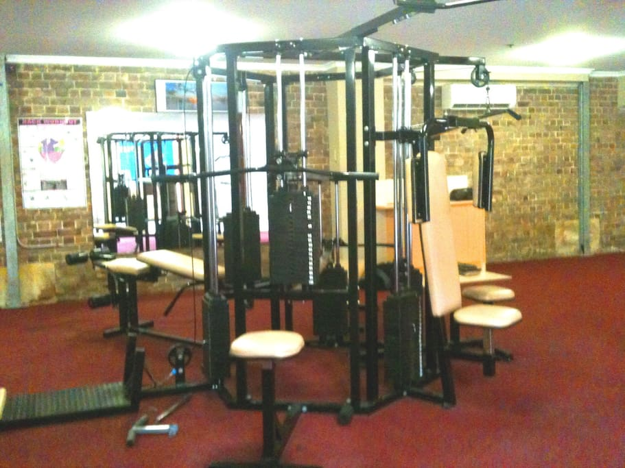 Weights gym complete with treadmill and rowing machines