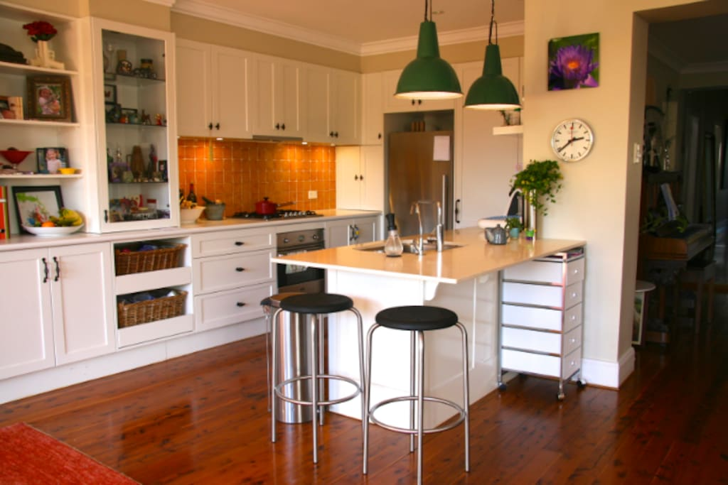Large contemporary functional kitchen opens onto living / dining room