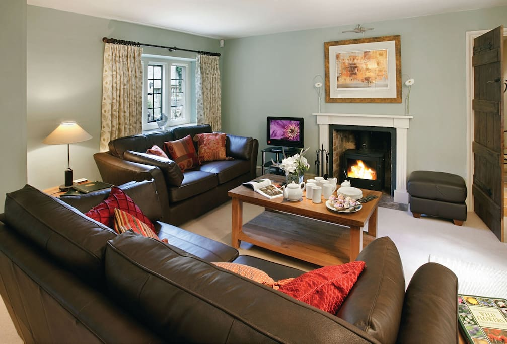 Ground floor: Large sitting room with wood burning stove and stable door to patio and garden