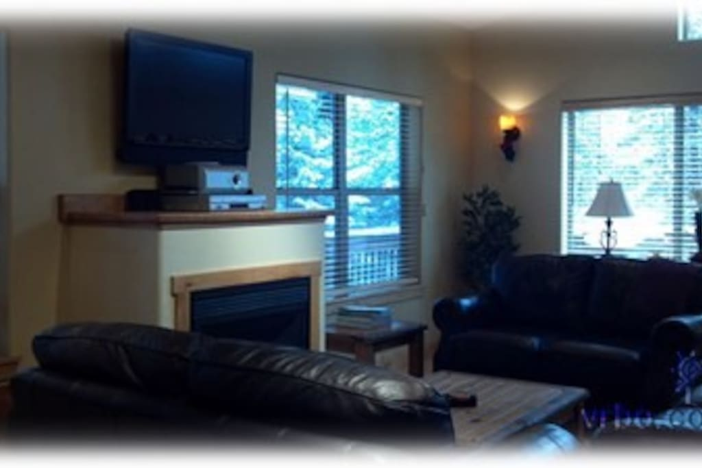 Great room with flatscreen tv and gas fireplace view home away242106 for photos, calendar, contact and other information