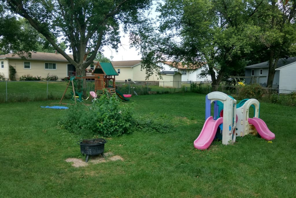 Large fenced in backyard with play structures.  Great for kids and pets..          . .......  ...  .. .   .. ..