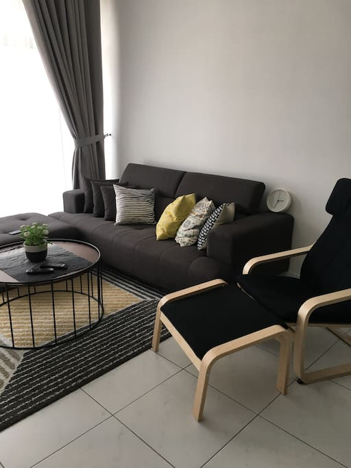 L-shaped couch with coffee table and lazy chair