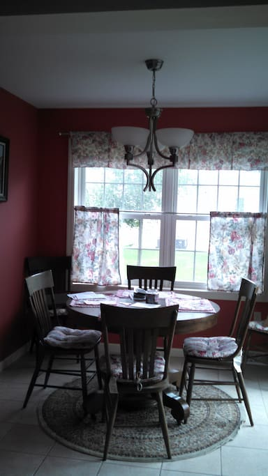 Bright dining room with plenty of room for you and your family.