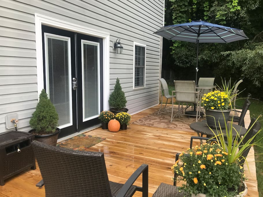 Entrance to Studio Apartment with a large deck, table and umbrella with four chairs to enjoy any meal outside along with four additional chairs to enjoy morning coffee or a glass of wine in the evening.