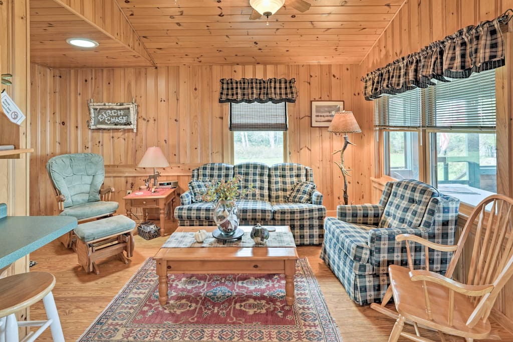 The interior boasts features of the quintessential cabin.