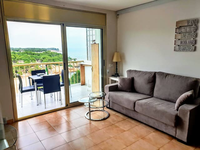 Light and spacious living room with sofa that converts to a comfy double bed.