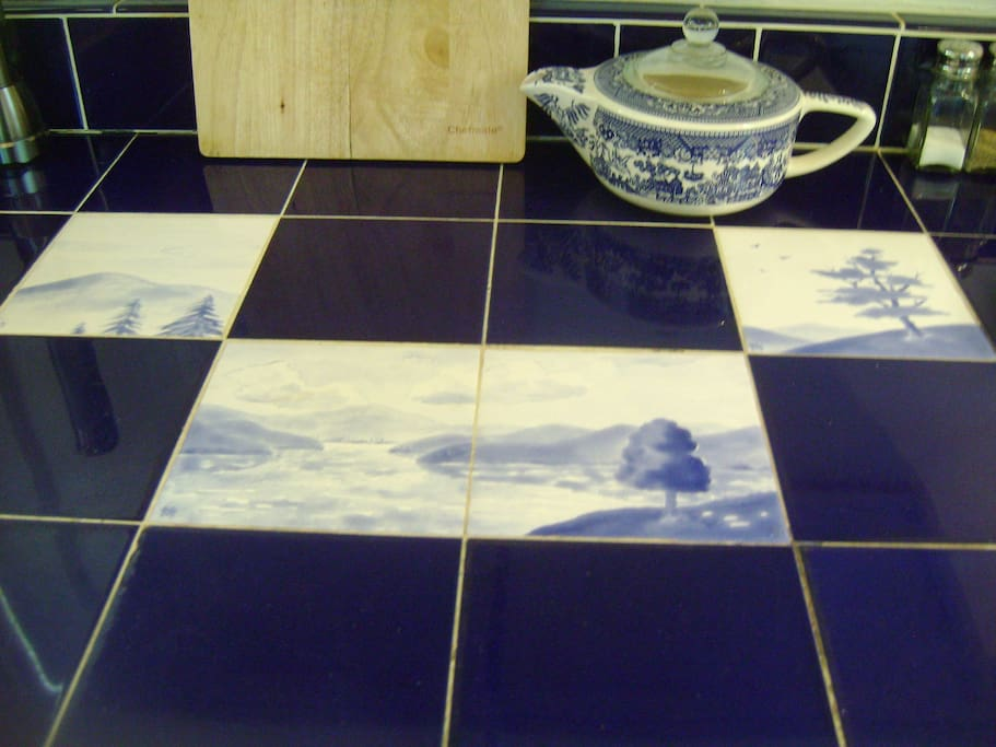 Custom tiles in counter by Woodstock artist John Freedman