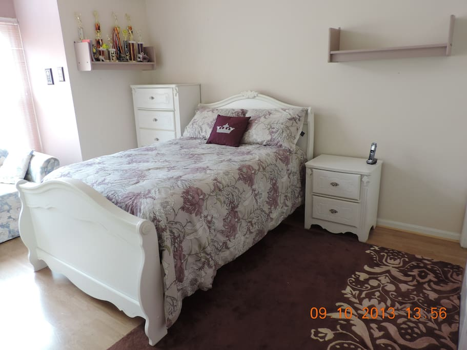 Same bedroom, different view. Comfortable full size bed.  Two closets in in this bedroom. It is my daughter's bedroom she uses in the summer and on holidays when visiting home from college; however, I have one more bedroom available with a small couch if