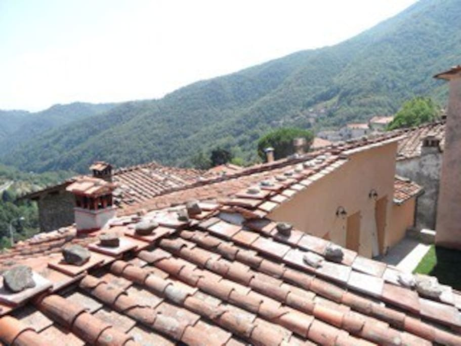 "Typical Tuscan roofs with views over the house towards the valley, taken from the ""Eagle Nest"" seating platform."